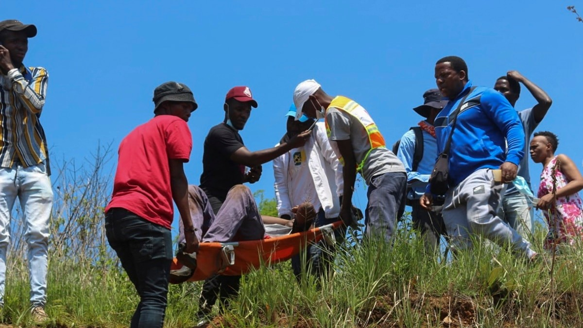 One of the injured nurses being carried in a stretcher